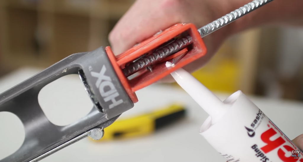 cut caulking tube with spout cutter